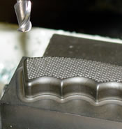 Graphite EDM electrode.  Carbon electrode machined with a CENTROID M-400 CNC control.  Note the smooth surface finish.