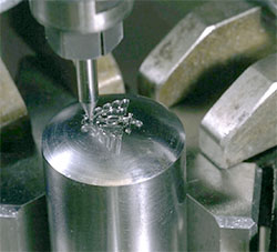 Small die being machined